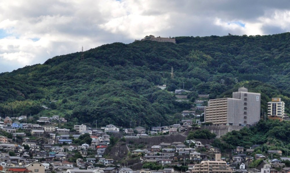 Yumihari no Oka Hotel, on Mt. Shokan-dake above Sasebo. You can also see the sharp point of the roof over the observatory, rising above the trees farther up the hill.