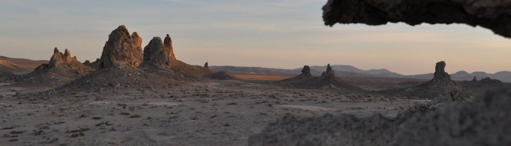 Sun strikes the spires rising from the dry lake bed.