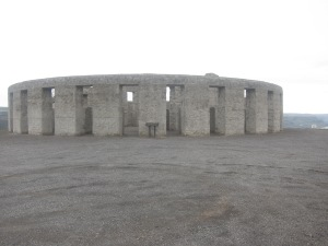 Stonehenge replica made of concrete and perched on a ledge above the Columbia River.
