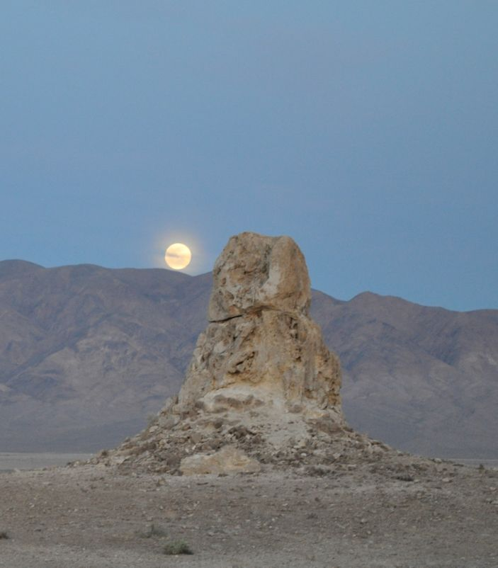Full moon rises in some thin cirrus behind a tufa spire.