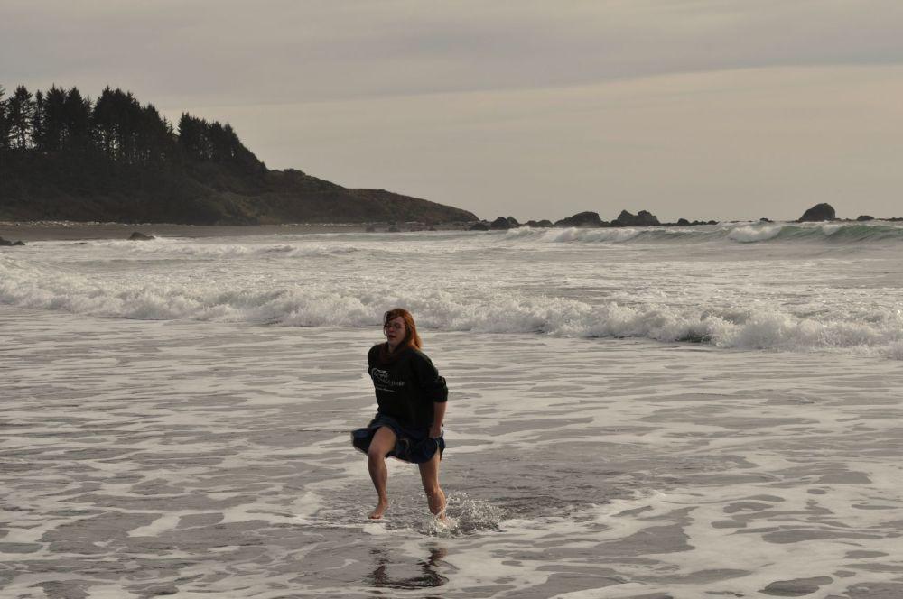 Miss Tara splashes through the waves in a skirt.