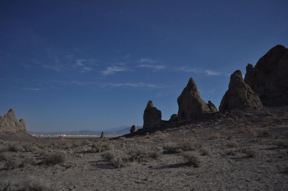 The lights of Trona are visible in the distance, and stars above make it seem peaceful here, though the wind was whipping at the time the photo was taken.