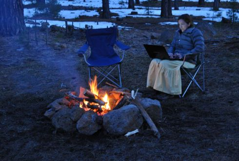Yes, I am blogging by the campfire. In a skirt. And a down jacket.