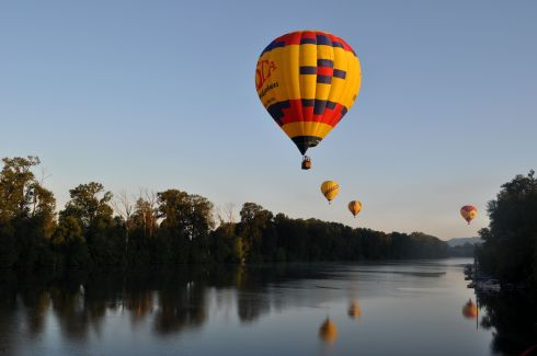 balloons hover above the Willamette River