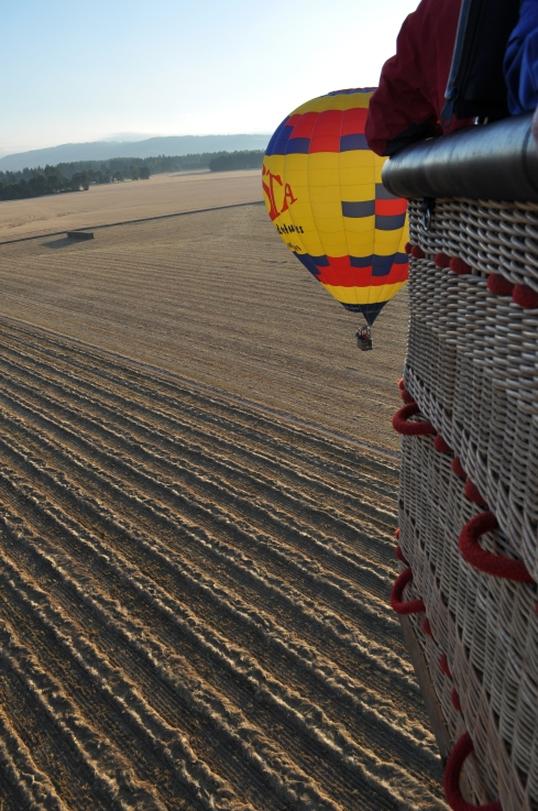 getting ready to land in a hay field