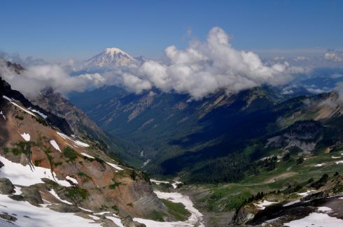 Steep valley with Mt. Rainier rising in the background to 14,410 feet. Goat Lake is in the cirque to the left.