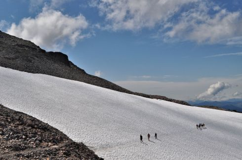 Hikers moving along the PCT as it crosses Packwood Glacier