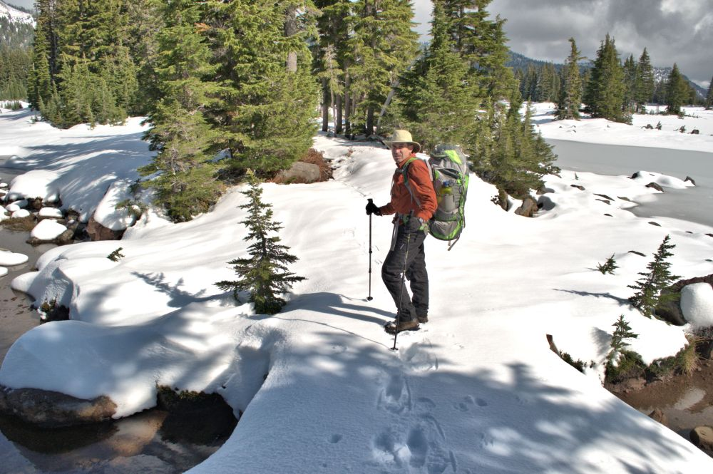Arno breaks trail where the snow shoes had only scuffed the surface.