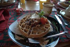 Belgian waffle with walnuts and strawberries and cookie butter.