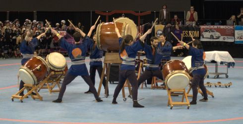 Portland Taiko in their finale: eating person beating multiple drums