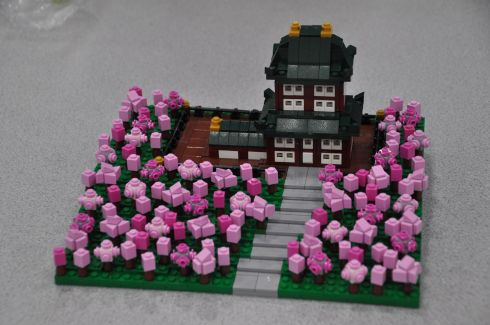 A temple surrounded by cherry trees.