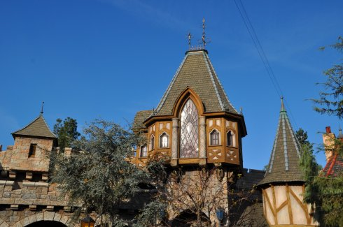 The park is contained in high stone walls with turrets and towers and royalty.