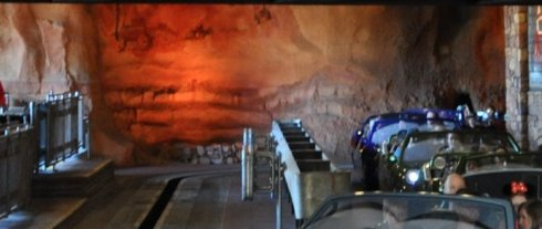 Cave paintings of old cars inside the Radiator Springs Racers ride.