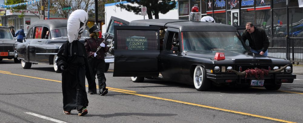 More comedy from the County Corner. There are all manner of the dead and mysterious marching with this hearse.