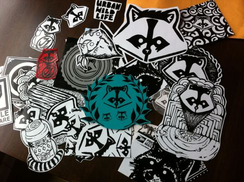A pile of unused raccoon stickers just waiting to find a home.