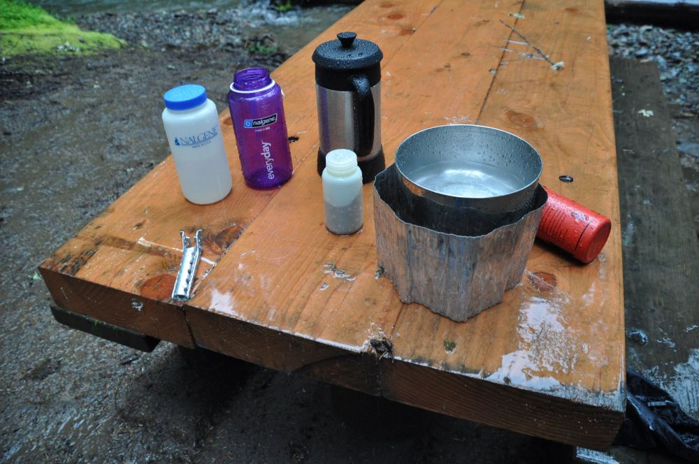 Saturday morning coffee preparations in the rain. Yes, my coffee tastes require a french press even in the woods!