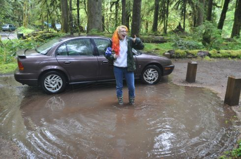 Since one of us had awesome rain boots, I parked on the edge of the site so I could step out onto mud, but she climbed out the door into a lake.