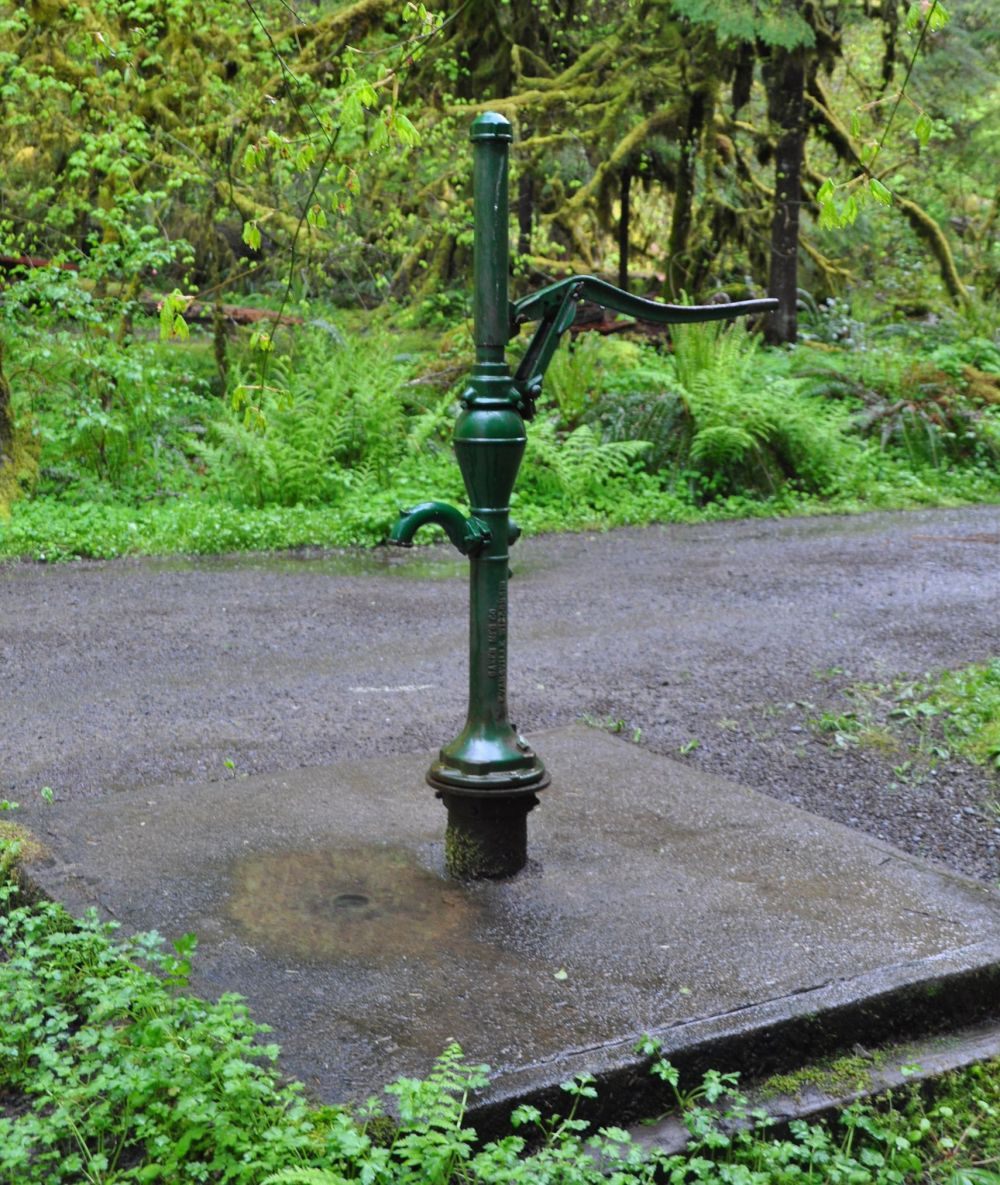 A water pump for campers. It's so pretty. Usually there is a spigot, but this - while providing the same service - is a pleasure to use.