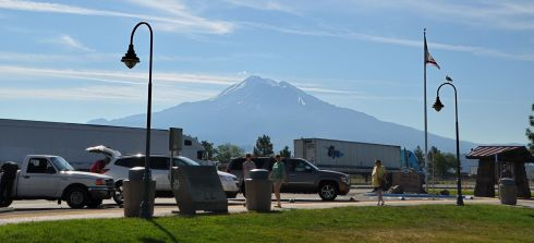 The volcano Mt. Shasta, rising in front of the sun at a rest area in Weed.