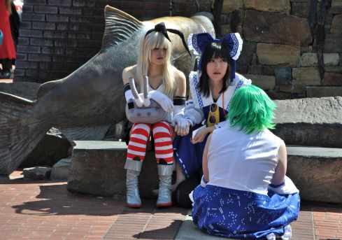 Cosplayers in conversation beside a giant fish in Esther Short Park in Vancouver, Washington