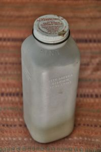 A plastic juice bottle filled with volcanic ash.