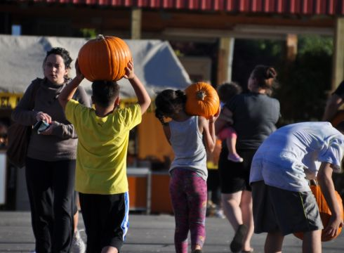 Kids hauling their treasures toward the parking lot.