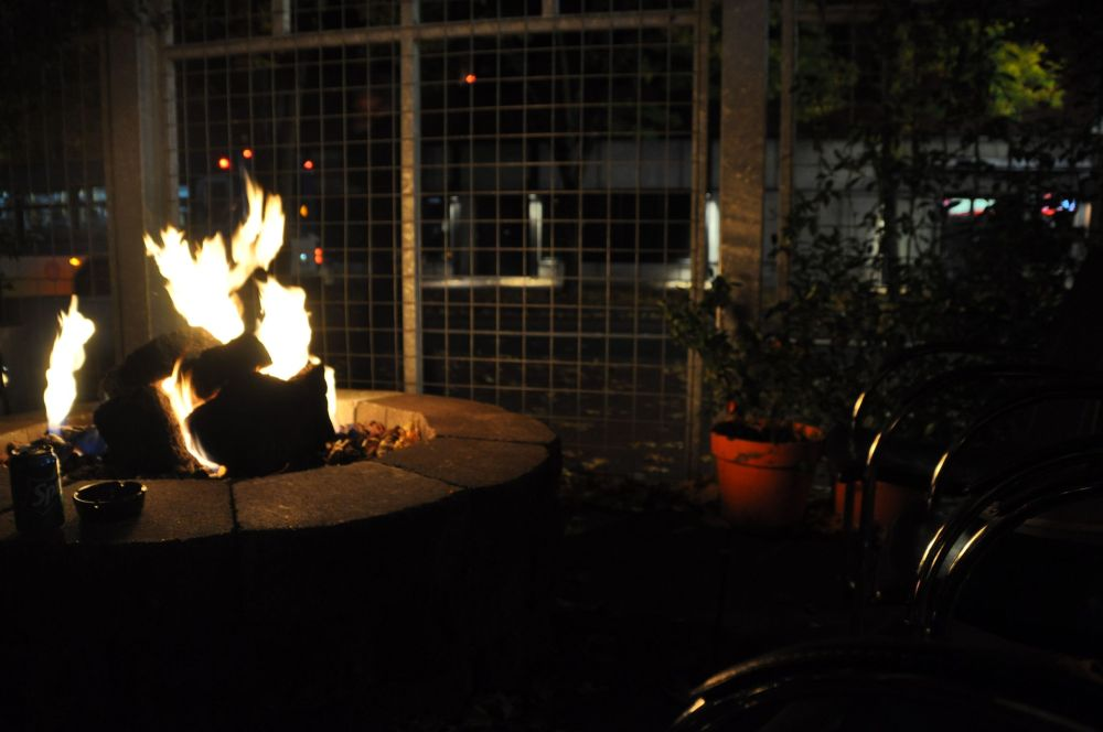 Enjoy the fire, a drink, a smoke, and watch people walk by on the street.