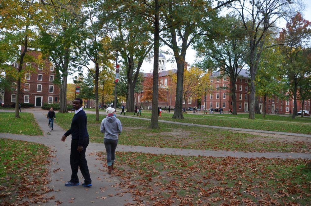 R and Tara walk through a Harvard courtyard