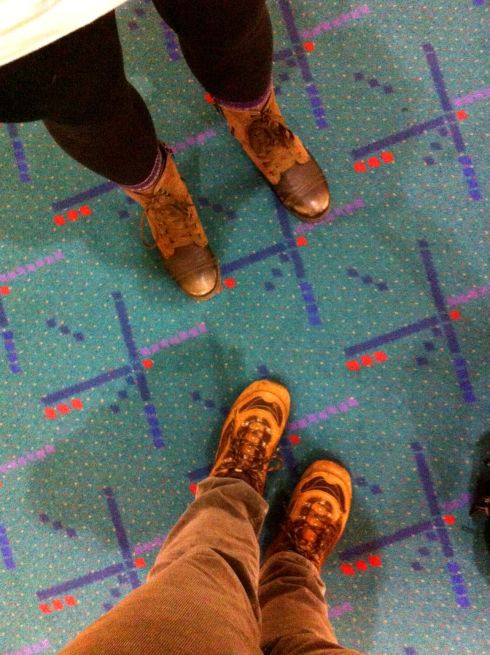 Our feet and shadows on the PDX carpet.