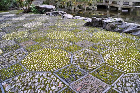 The stone tiles are particularly remarkable throughout the garden. The pattern changes to suit each section.