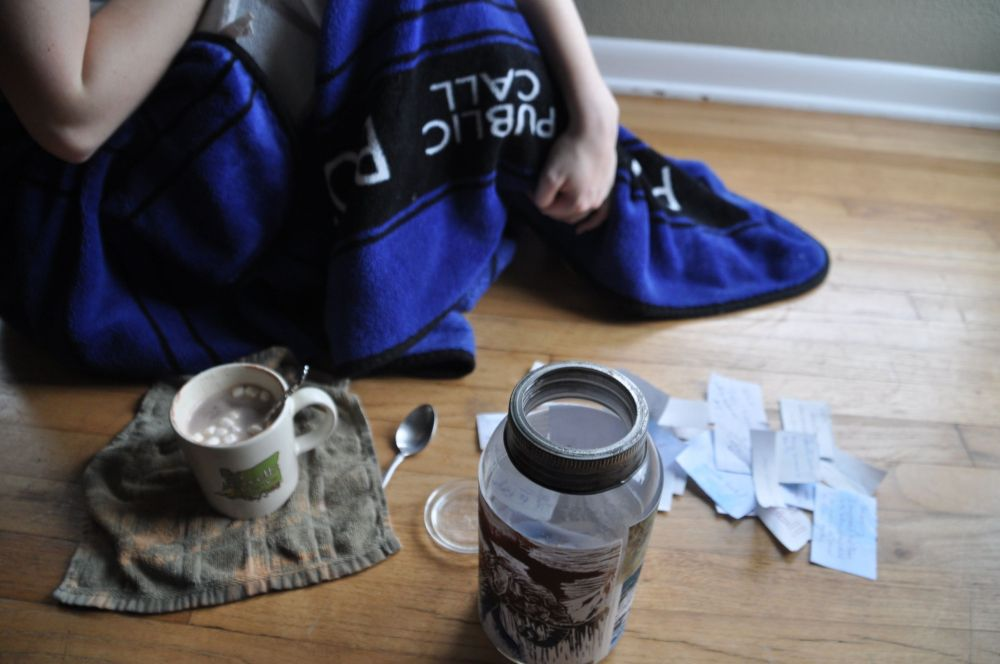 Tara with the TARDIS blanket and hot cocoa, and the good things jar.