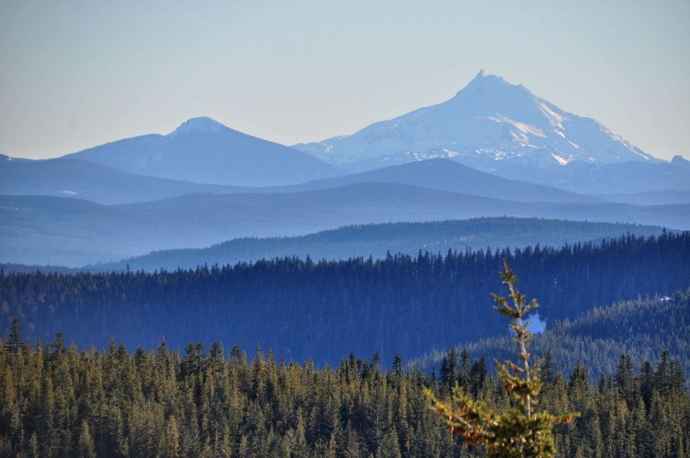 Mt. Jefferson to the south, beyond hazy azure hills.