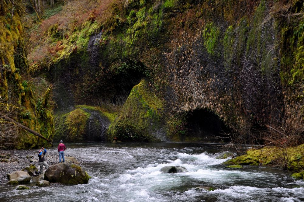 The area above Lower Punchbowl Falls has a rocky beach area that can hold a lot of people who want to enjoy the shade and cool breezes in the summer. In February, there's just a guy taking pictures of his girl. :-)