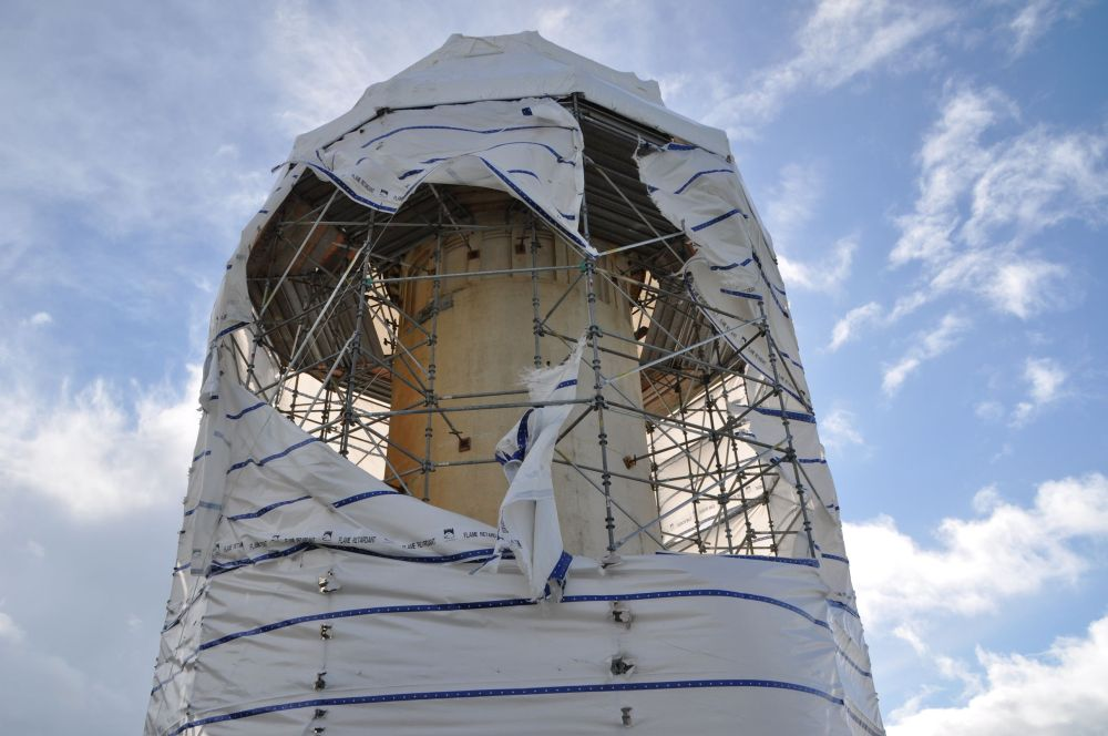 We saw two lighthouses. The second one was at Cape Disappointment, but this one, called North Head Lighthouse, was more of a disappointment. It was all wrapped up for repairs, except for the part the winds have torn off.