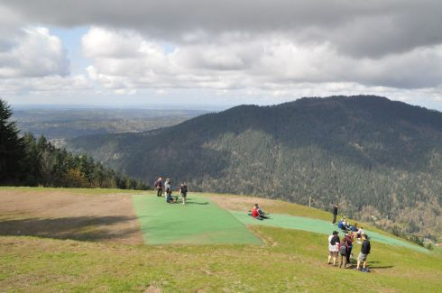 Paragliding launch spot at the top.