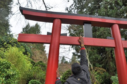 Entering the Japanese garden, I had M place a pebble onto the Torii gate for us. While I was in Japan, it was explained to me that, since the torii is a gate to the spirit world, the rock holds a connection back to your own world, so you have a better chance of being able to return. I don't know if it's a true Japanese tradition, but I love it. Torii that I saw in Japan frequently had pebbles along the top.