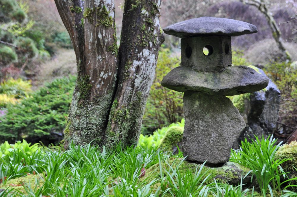 Lantern balanced on an uneven rock.