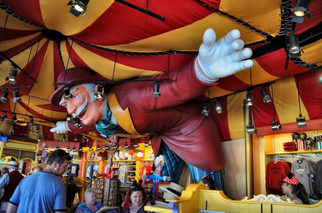 A larger-than-life ringmaster holds up a tent in Disney California Adventure Park.