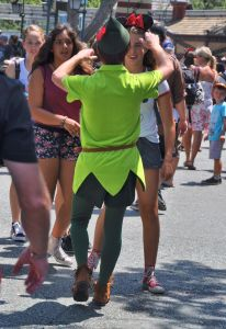 Peter Pan has adoring fans. Just catch a load of the face on this girl as she realizes who is walking toward her.