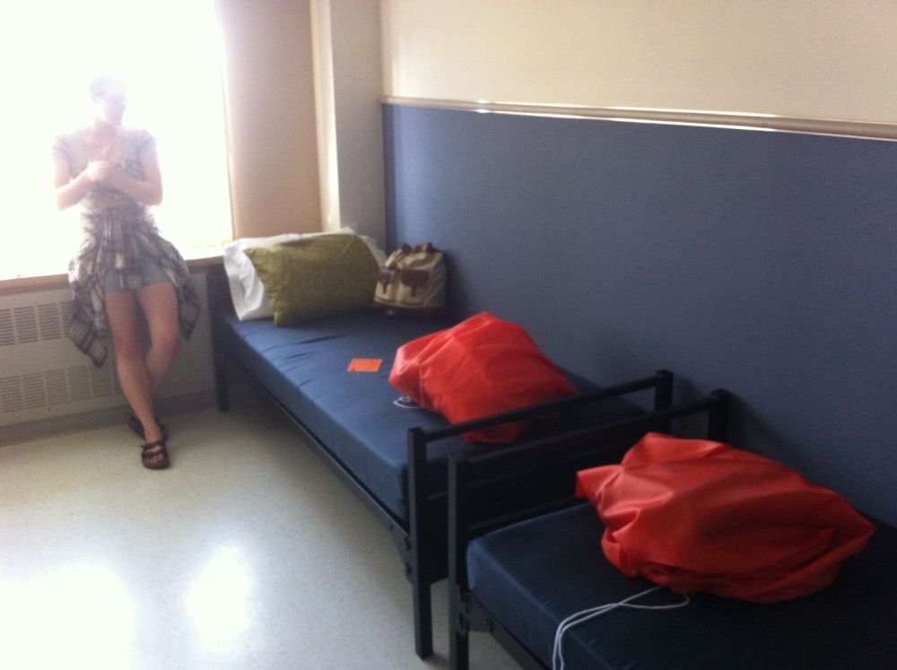 Tara checking out their Oregon State University dormitory room during orientation last week.