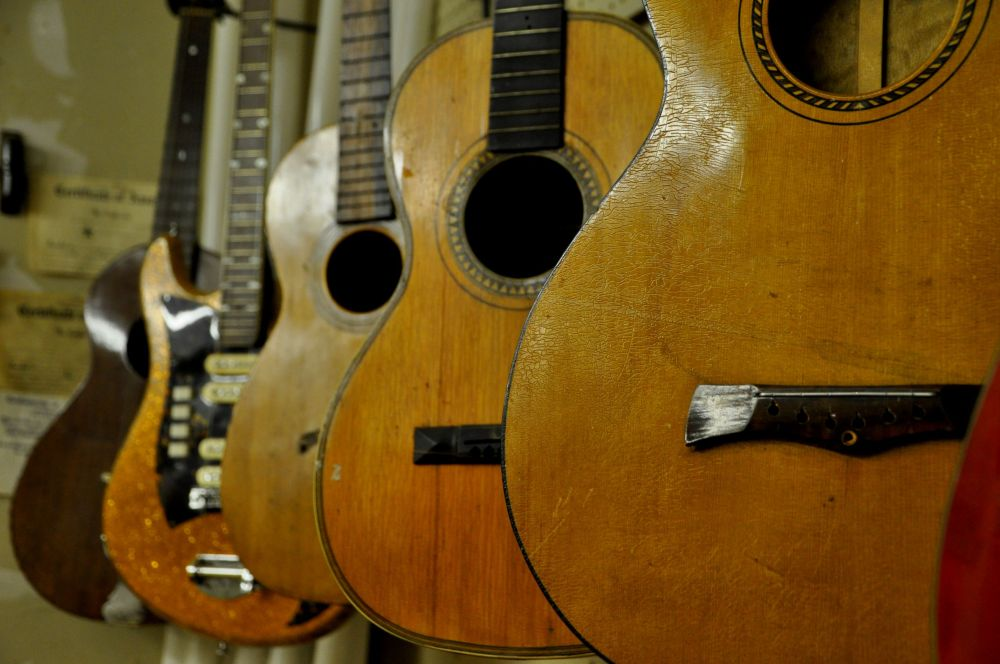 Guitars waiting for the tender touches of repair work.