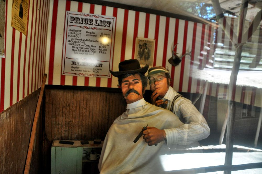 In Tofteville, a barber and his client appear startled to see me.