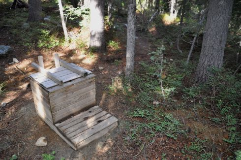 A mountain toilet. You lift the lid, and sure enough there it is! I find this hilarious... though probably necessary in this very popular wilderness area that fills with inexperienced hikers every summer.