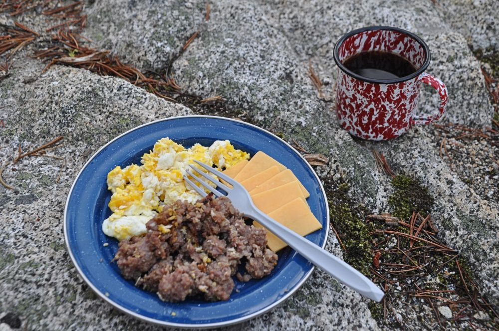 Roughing it? Says who? I do breakfasts too. Here you see the remainder of the sausage, scrambled eggs, sliced cheese and coffee (in the coffee/wine/alfredo all-purpose tin cup).
