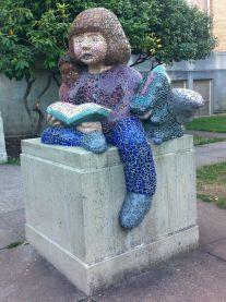 This mosaic sculpture is beside the front door.