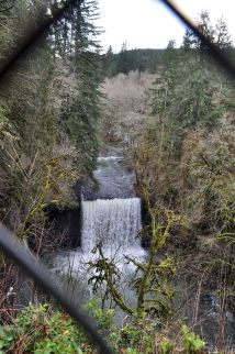 Beaver Falls from the road, through a protective chain link fence.