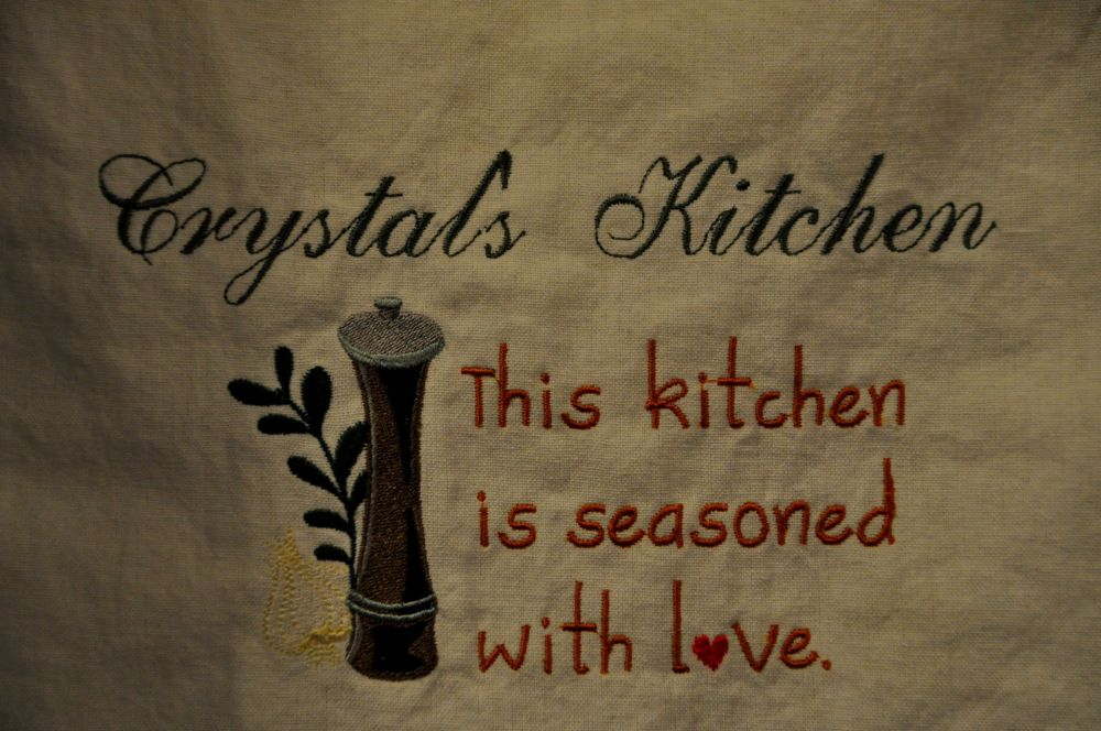 Close up of the kitchen towel that Marlene made for me as a housewarming gift.