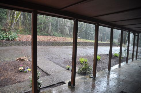 The rain was gushing today, but the ample front porch keeps the front of the house dry.