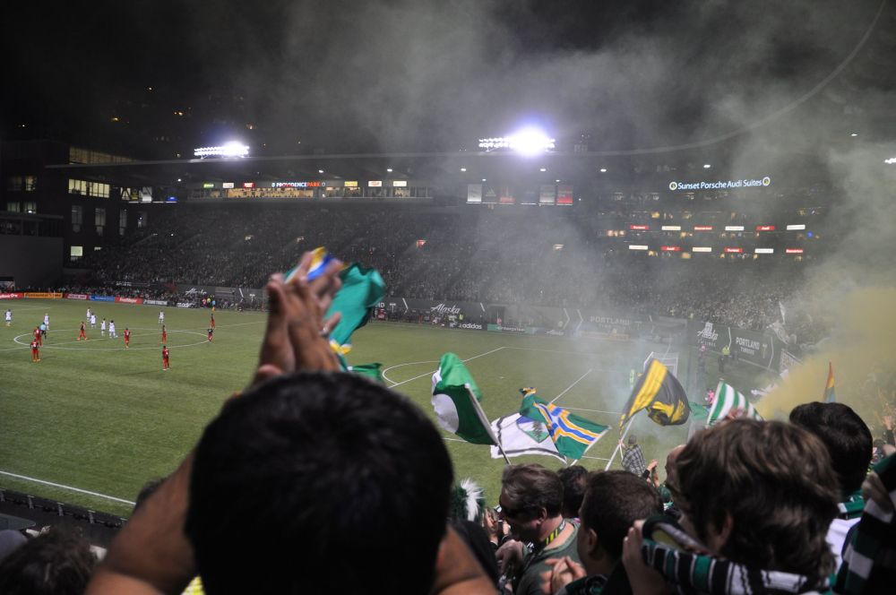 Flags and smoke in the air.
