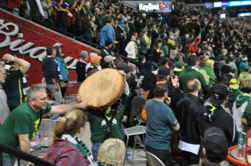 Here, Jim hauls the wooden disc through the crowd so people can touch it.
